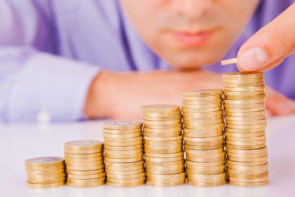 Businessman saving money concept