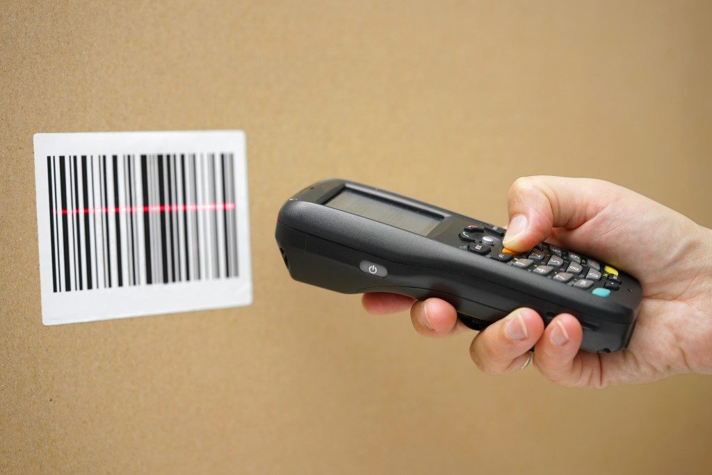 man using a barcode scanner