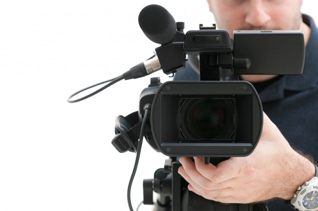 man operating the video camera