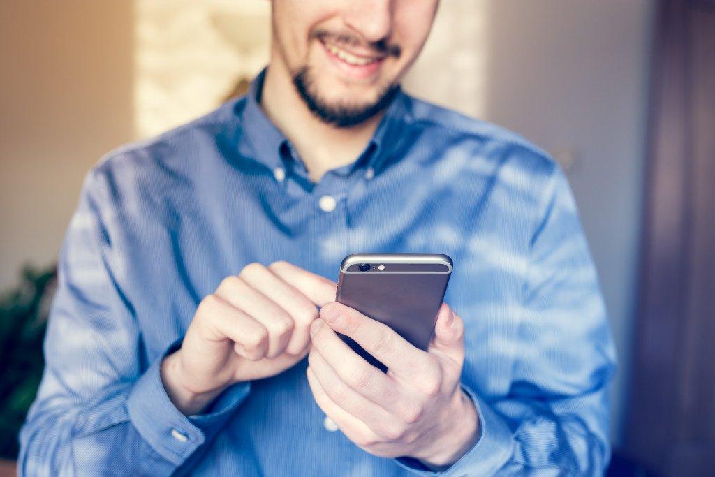 man holding his phone